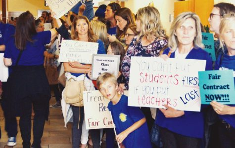 Protesters line up and advocate for higher-quality classroom sizes and an efficient and honest contract at the SMUSD board meeting last month.