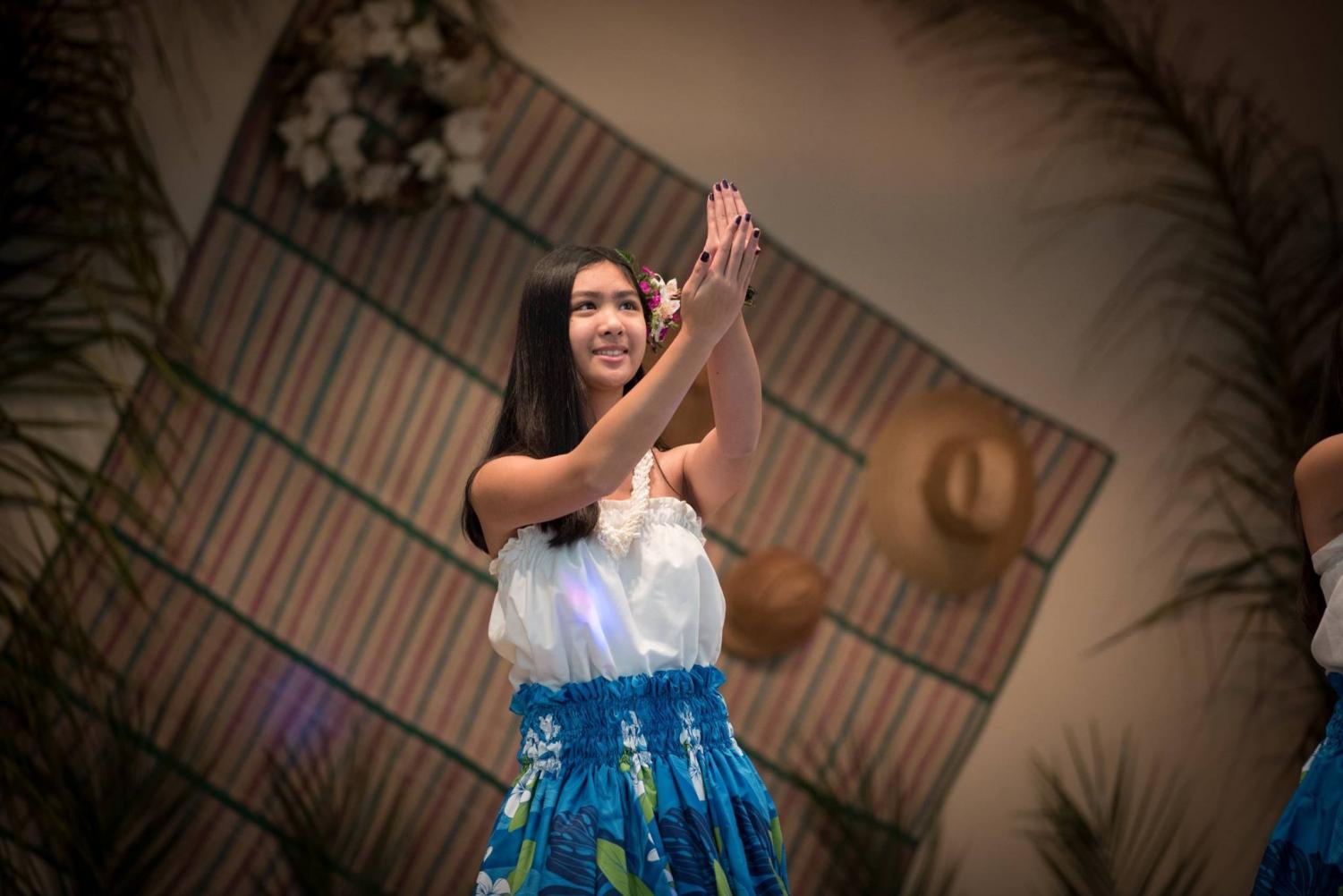 Kyla Avendano dances hula for  the Mother's Day Dinner Dance Luau.