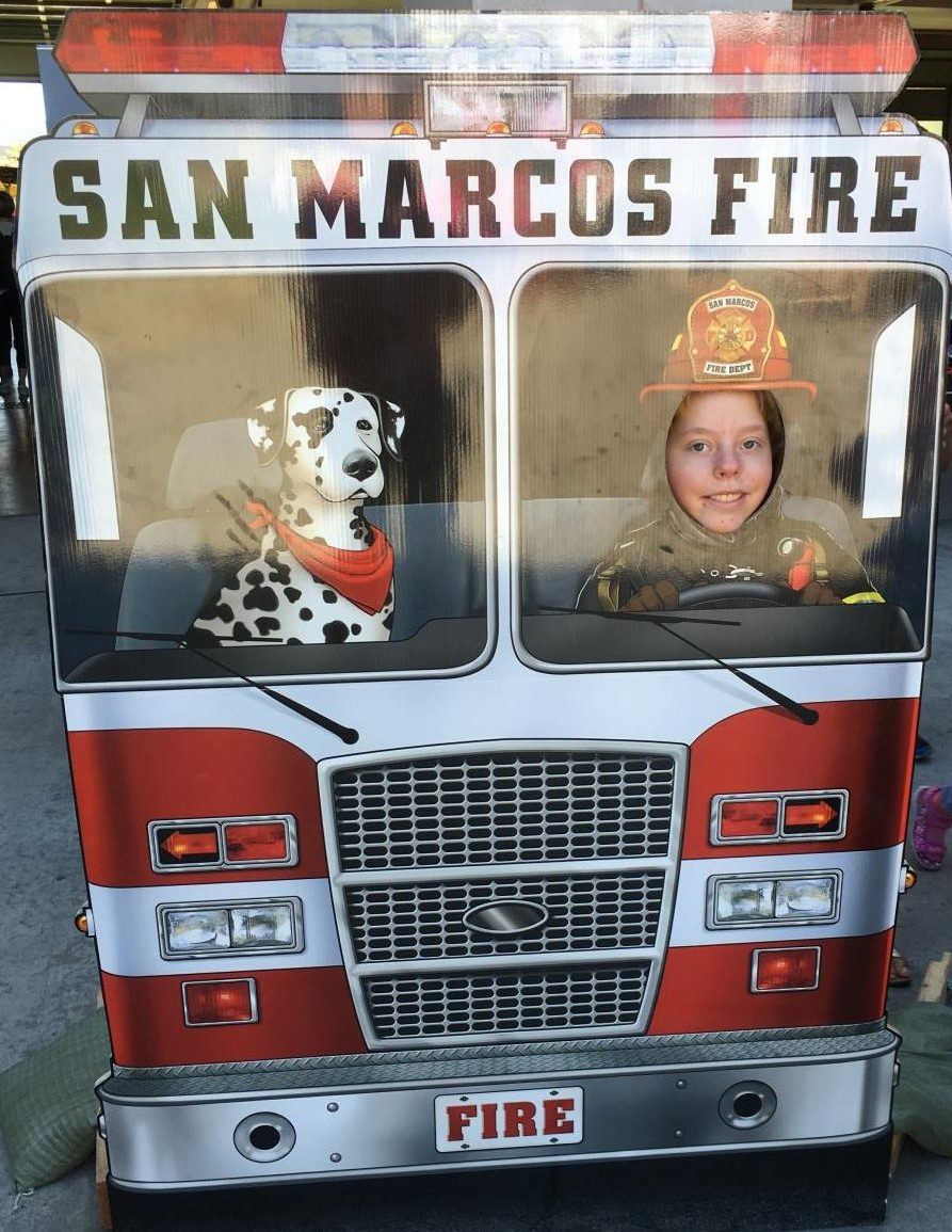 Abby Larson (11)  gains insight into firefighting as she spends time with Sparky.