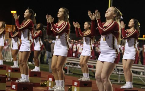 Cheer gets the crowd hyped up at the homecoming football game against Oceanside High School (October 4th).