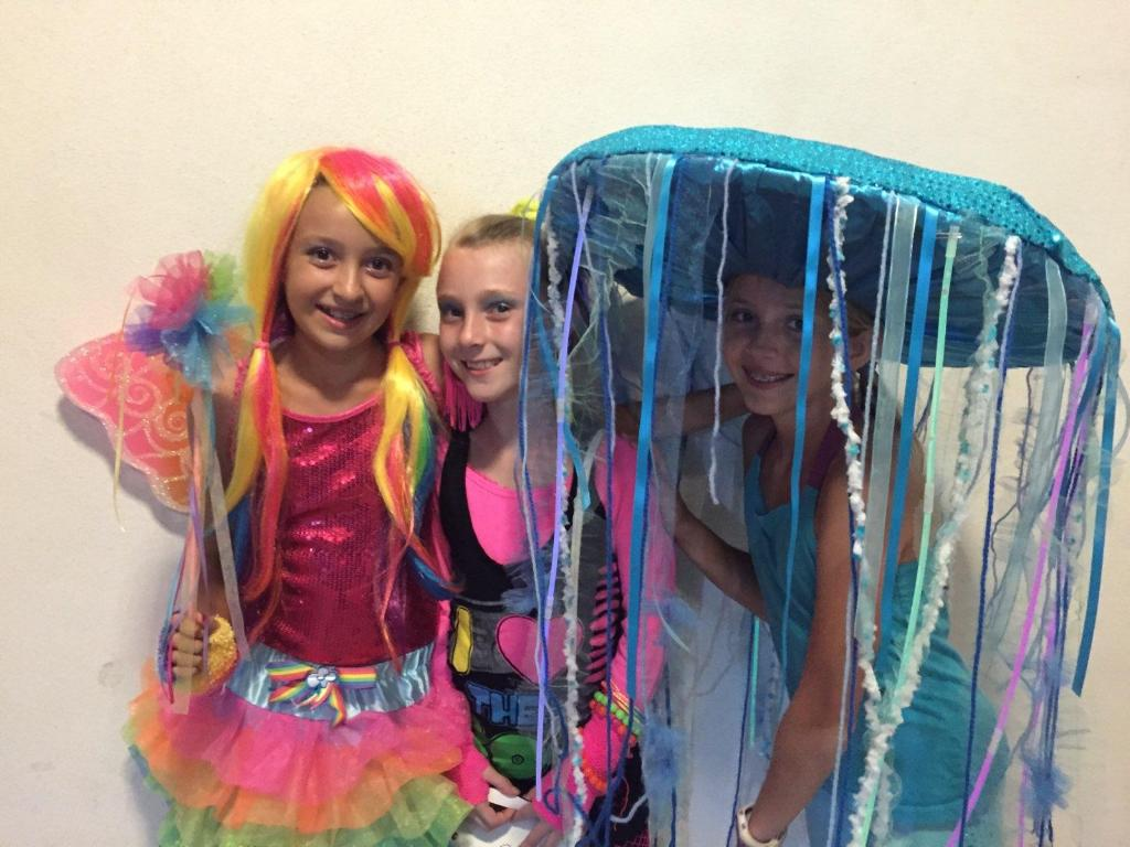 Alyssa Mandell (9) happily poses in her homemade jellyfish costume alongside Lauren Buckingham (9) and Reagan Barnum (9).