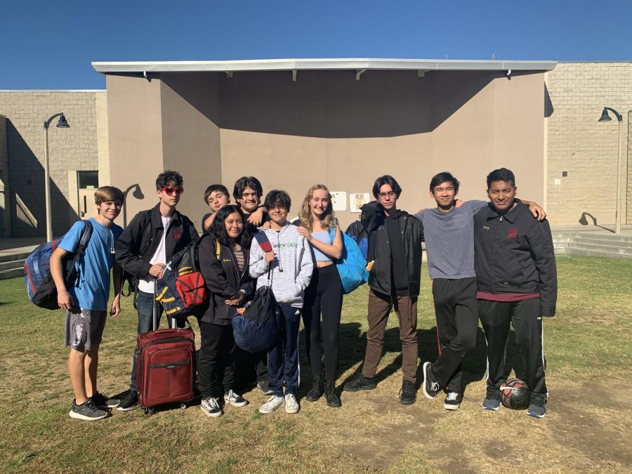 Keegan Mckee (11), Lucas Burke (11), Arlene Bedolla (10), Conner Roesller (10), Chris Villegas (9), Sophia Novelo (10), Camille Wetherell (10), Jorge Barajas (11), Thien Huyhn (11), and Kenny Cruz (11) wait for their bus to the new adventures and experiences that await them in Utah.