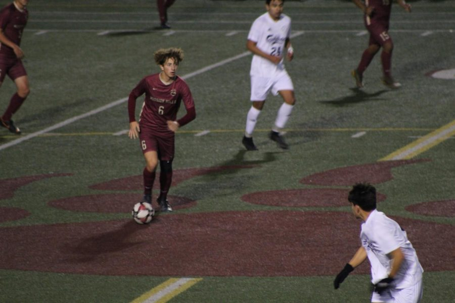 Cameron Rosa (11) dribbles the ball down the field, looking for a pass in the team's game against Carlsbad High School (1/23).
