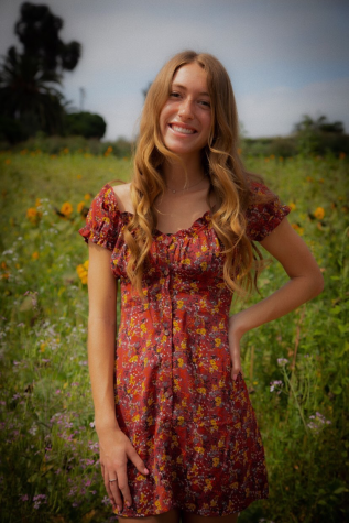 Smiling girl standing in field