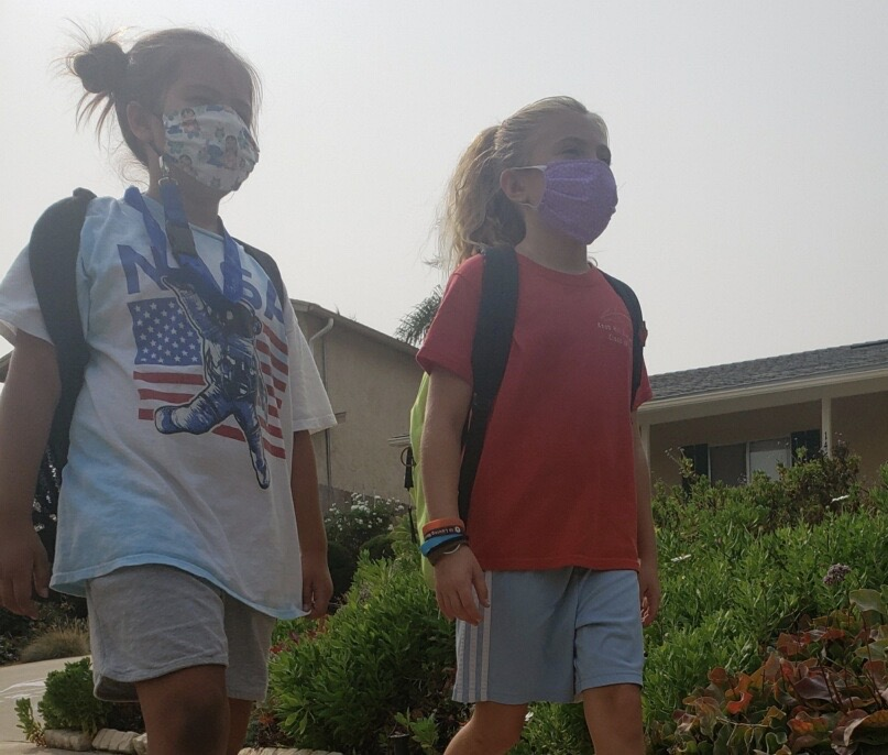 Students are seen wearing masks for their safe transition back to school.
