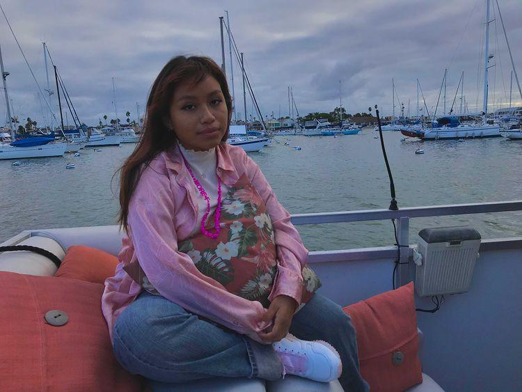 Evelyn+Vasquez+%2811%29+gets+her+picture+taken+as+she+sits+in+a+boat.