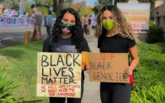 President Michyla Huff (12) and Vice President Jaedyn Hoenig (12) holding their signs at a Black Lives Matter protest.