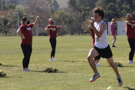Senior Daniel Krough striding to the finish line at Cross Country meet on Saturday, 2/27.