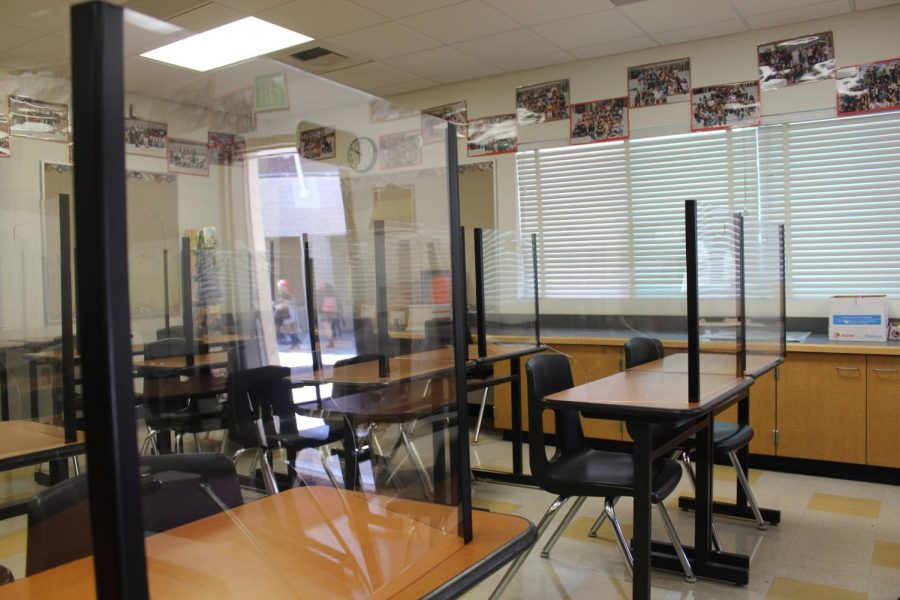 Plexiglass dividers and spaced out desks ensure a safer environment for students learning in smaller classroom settings.